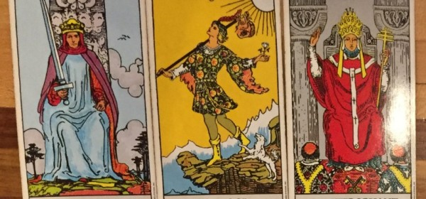 Three cards side by side symbolizing a group in the tarot reading